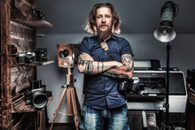 Beautiful Portrait Of The Photographer At The Workplace. The Concept Of The Creative Process, Skill And Favorite Pastime