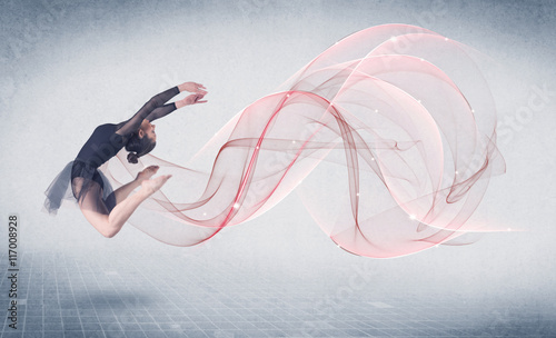 Photo Dancing ballet performance artist with abstract swirl
