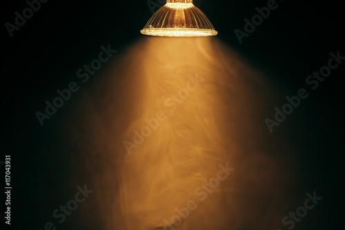 Obraz halogen lamp with reflector, warm light in fog - fototapety do salonu