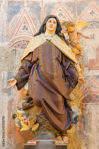 AVILA, SPAIN, APRIL - 18, 2016: The polychrome carved statue of St. Theresia of Avila in Catedral de Cristo Salvador by unknown artist from year 1964.