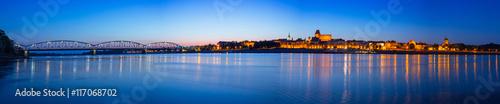 Foto op Aluminium Nachtblauw Panorama of Torun at night reflected in Vistula river, Poland