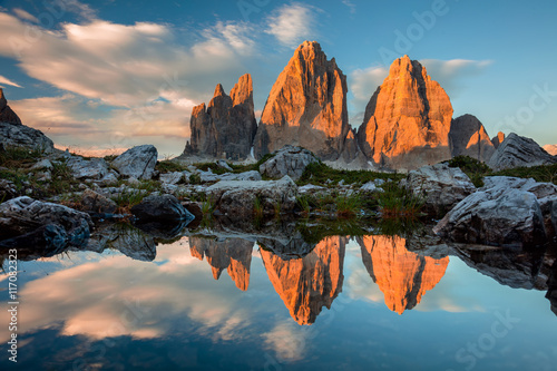 Fotografia, Obraz  Tre Cime di Lavaredo with reflection in lake at sundown, Dolomit