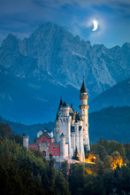 Famous Neuschwanstein Castle At Night With Moon And Illumination