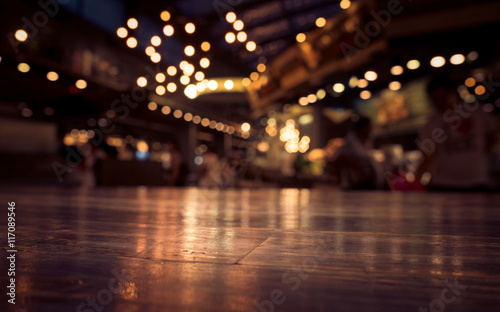 Foto op Plexiglas Restaurant Empty wood table top on blur cafe restaurant in dark background