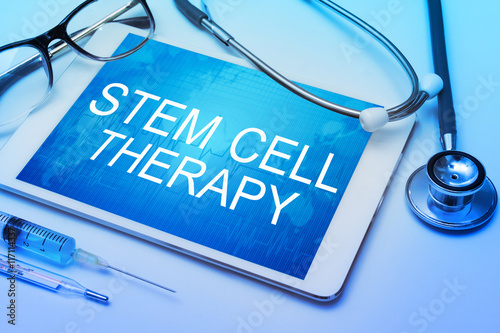 Fototapeta stem cell therapy word on tablet screen with medical equipment on background obraz