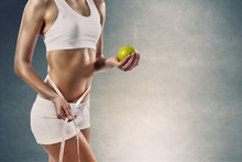 Sport Girl With Measure Tape And Green Apple