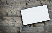 Empty Board On Wooden Table