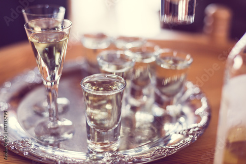 Closeup of glasses filled with snaps (schnaps alcohol) on table during Swedish Midsummer celebrations in June Canvas Print
