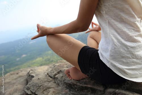 Foto op Canvas School de yoga young fitness woman practice yoga at mountain peak cliff