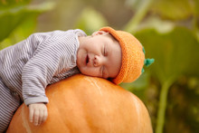 Baby With Pumpkin Hat Sleeping...
