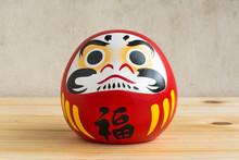 Daruma Doll Japanese Symbolise On Wood Table