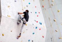 Man Climbing On Artificial Bou...