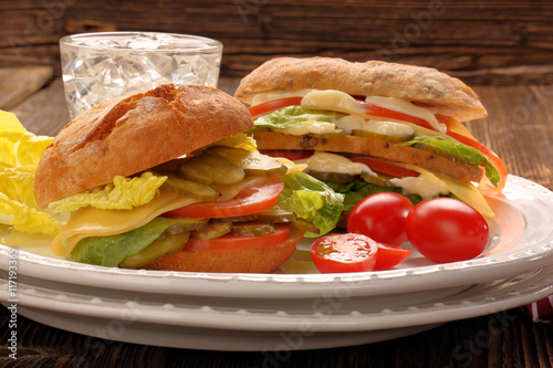 Staande foto Snack Fresh vegetarian sandwiches with tomato and cucumber on the plat