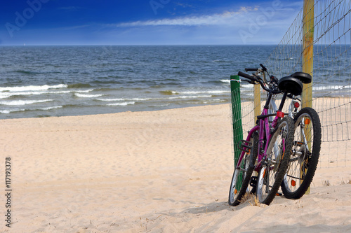 Foto op Plexiglas Two bicycles on an empty beach
