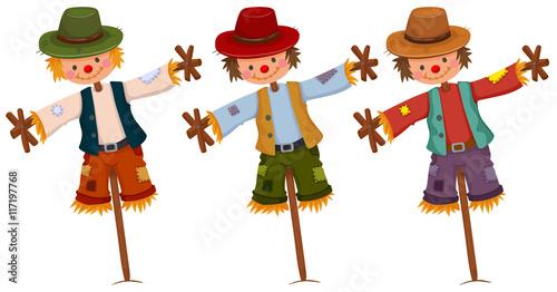 Obraz na plátně Three scarecrows on wooden sticks