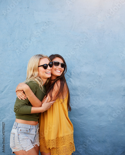 Young women having great time together Wall mural
