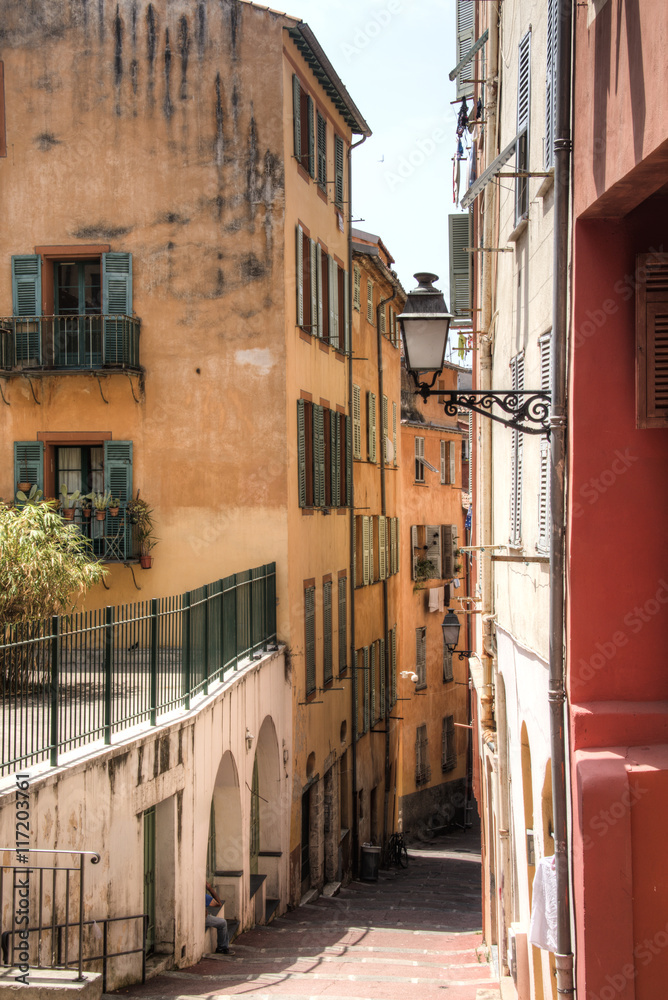 Facades of houses in a small street in Nice on the French Riviera