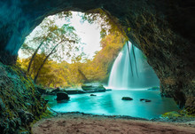 Amazing Cave In Autumn Deep Forest With Beautiful Waterfalls Background At Haew Suwat Waterfall In Khao Yai National Park, Thailand