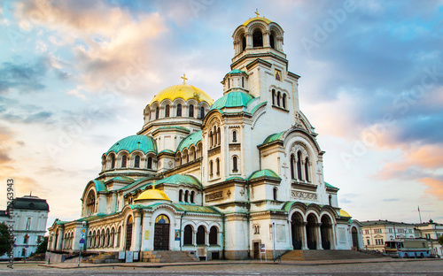 Fotobehang Monument St. Alexander Nevsky Cathedral in the center of Sofia, capital of Bulgaria against the blue morning sky with colorful clouds