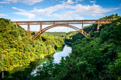 Foto op Aluminium Brug iron bridge over the river Adda Lombardia Italy
