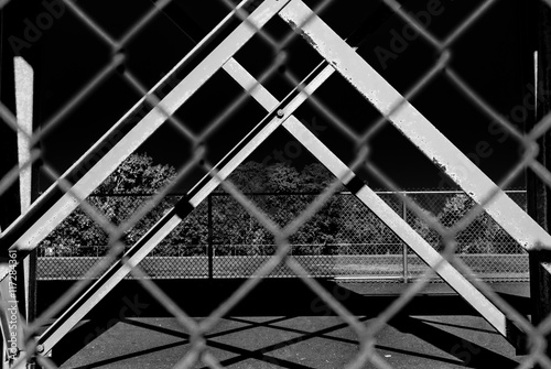 Fotografie, Obraz  Outdoor chain link fence with steel beam background