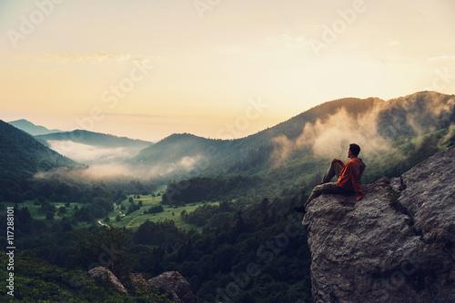 Fotografie, Obraz Explorer man enjoying view of sunset