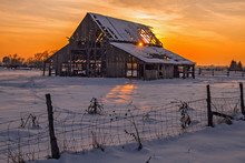 Old Barn In Winter With Colorful Sunset