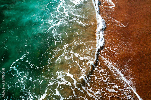 Sea surf at waters edge