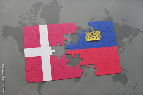 Photo  puzzle with the national flag of denmark and liechtenstein on a world map background