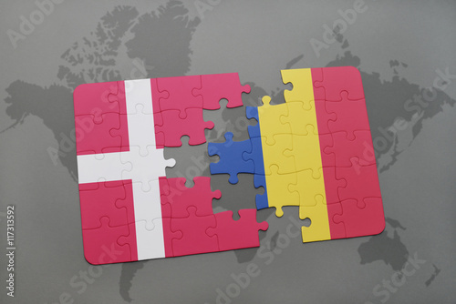 Photo  puzzle with the national flag of denmark and romania on a world map background