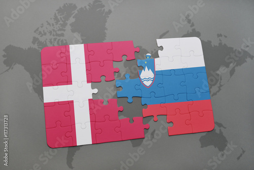 Photo  puzzle with the national flag of denmark and slovenia on a world map background