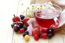 Mix Fruit Tea In A Glass Cup And Fresh Berries