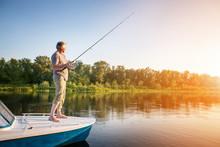 Mature Man On A Motor Boat. Fishing