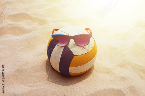 Photo  Beach Volleyball and Sunglasses in Natural Summer Sunlight
