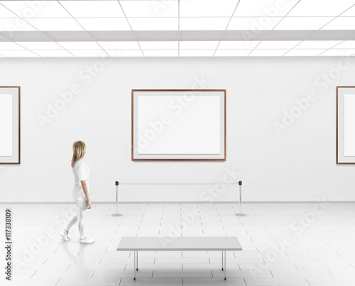 Modern gallery wall mockup. Woman walk in museum hall with blank ...