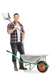 Gardener posing with gardening equipment