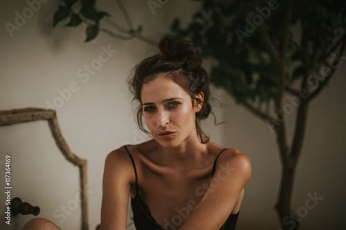Passionate woman in black bra and hairstyle Poster