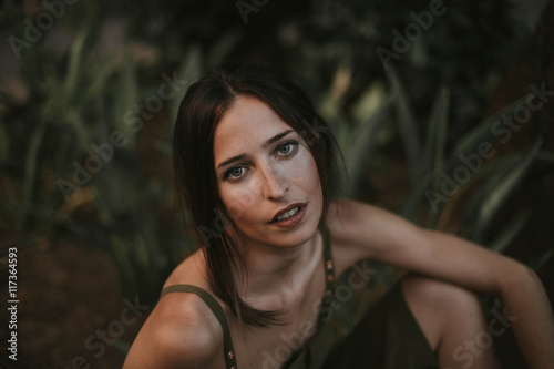 Plagát  Sensual brunette woman in khaki looking at camera