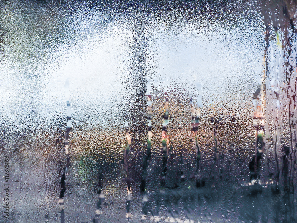 Fototapeta Water drops from home condensation on a window