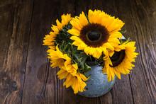 Sunflowers In Retro Metal Vase