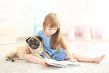 Cute Girl Reading Book With Do...