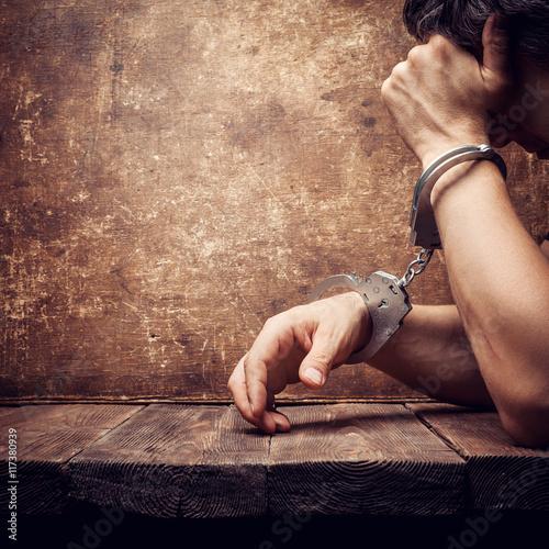 Fototapeta male hands in handcuffs