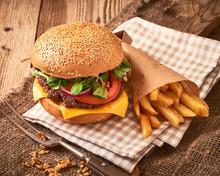 Fresh Homemade Hamburger  With Cheese, Tomatos, Green Salad And