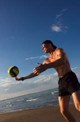 FototapetaBeach volleyball. The player makes the pitch.