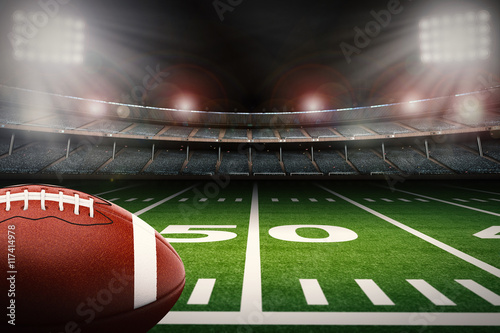 Fotografiet  american football ball on green field
