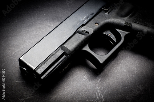 Canvas Print hand gun on black background