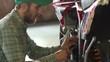 male sportsman repairing his enduro motorcycle
