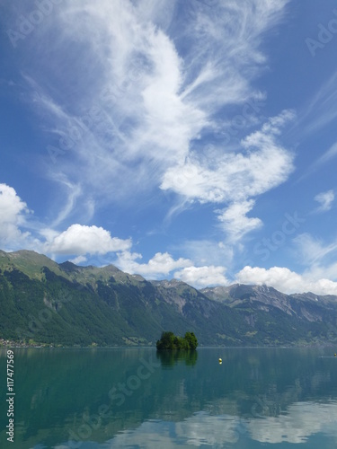 Valokuva  Windswept clouds above Brienzersee Lake, Switzerland and the Brienzer Rothorn mo