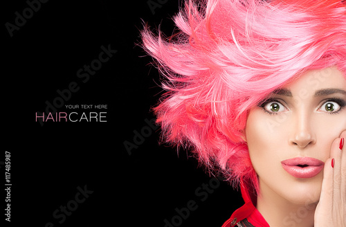 Foto auf Leinwand Friseur Fashion model girl with stylish dyed pink hair