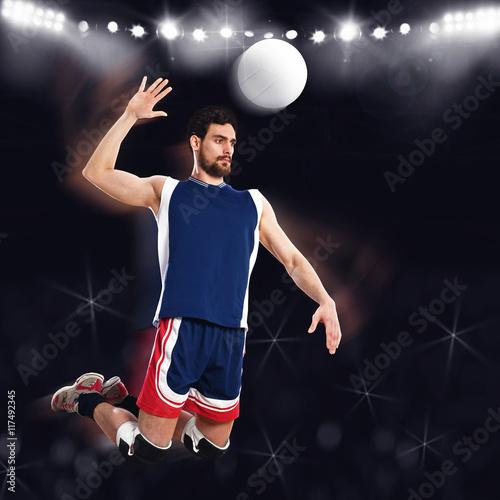 Volleyball player beats ball - 117492345